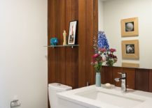 Mahogany panels add elegance to the contemporary bathroom without disturbing the color scheme