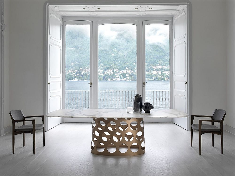 Marble top dining table with cool metal base is a showstopper