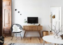 Midcentury modern wooden sidetable below the wall mounted TV 217x155 Serenely Scandinavian: Light Filled Renovation of Lisbon Apartment