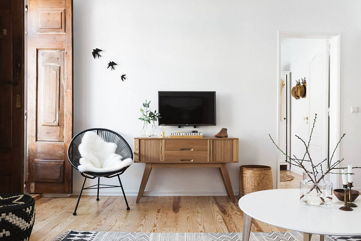 Midcentury modern wooden sidetable below the wall-mounted TV