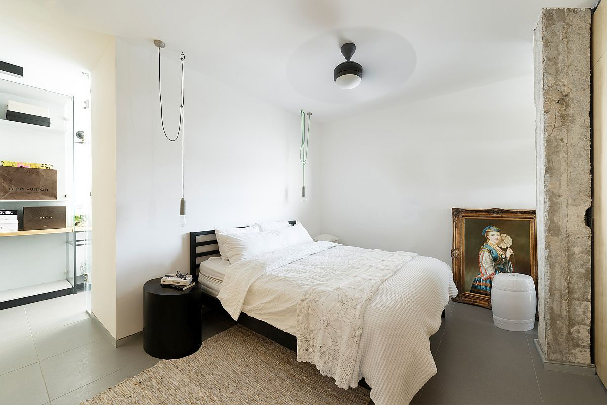 Minimal modern guest bedroom on the top level of the Tel Aviv home