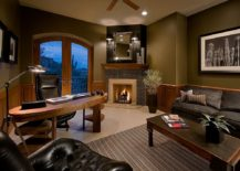 Mirror-above-the-fireplace-adds-a-hint-of-glam-to-the-home-office-217x155