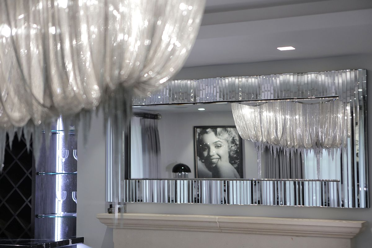 Mirrored finishes and silvery decor enhance the art deco aura of the home