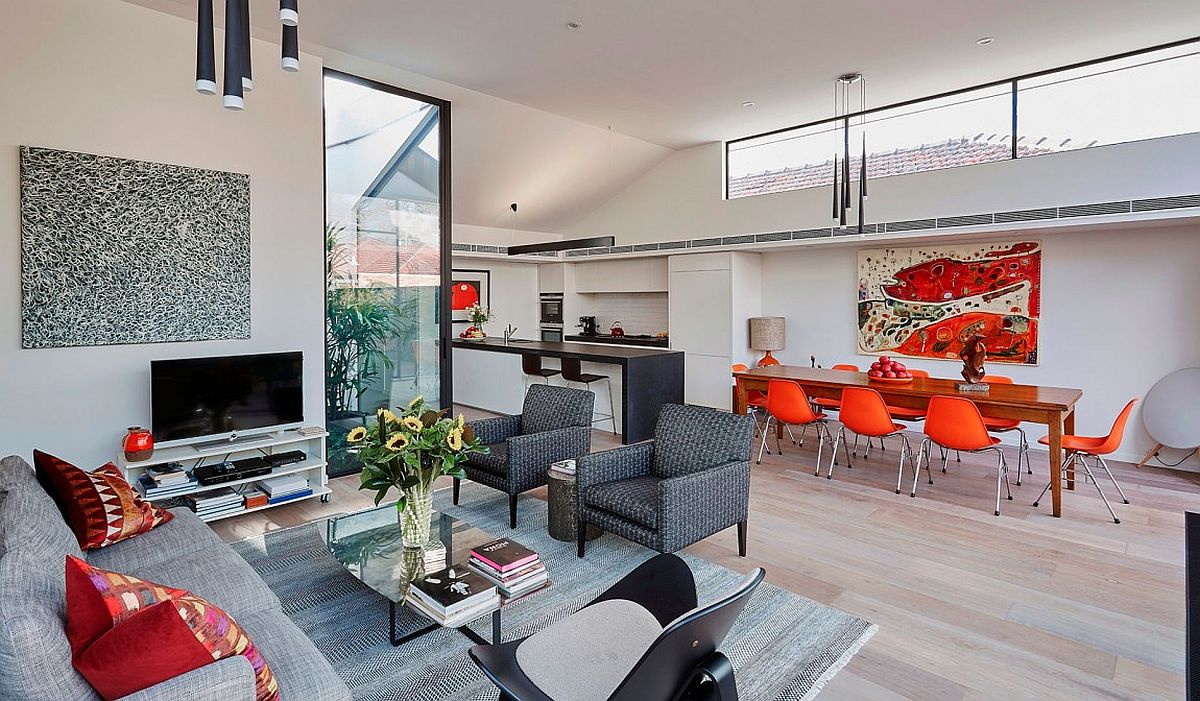 Modern and elegant decor along with pops of color for the open living