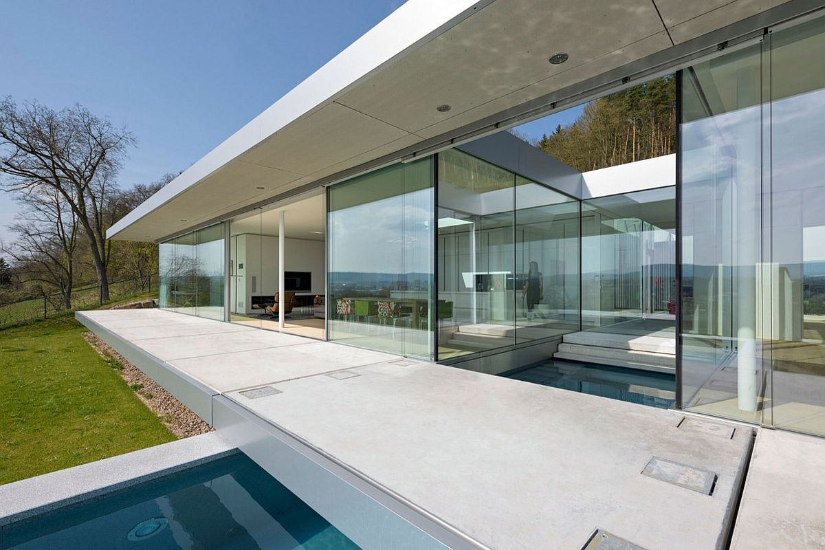 Modern minimal villa in Germany where the pool intersects with the house