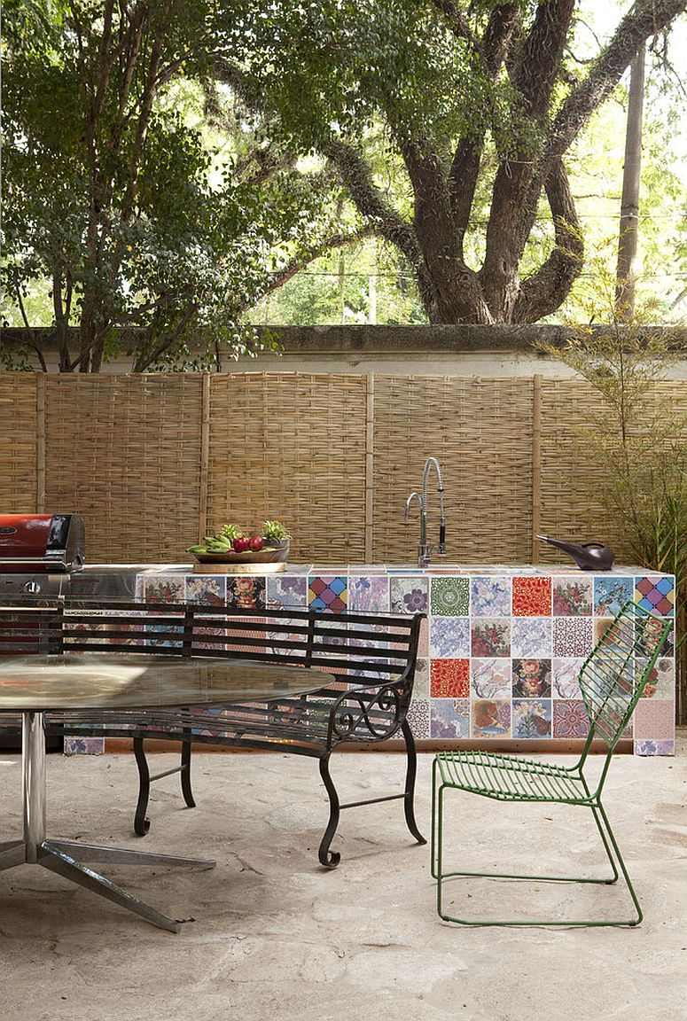 Modern patio with a colorful display of a patchwork of tiles [Design: Fabio Galeazzo/ Photo: Marco Antùnio]