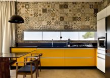 Monochromatic approach to patchwork of patterned tiles is great for the modern kitchen