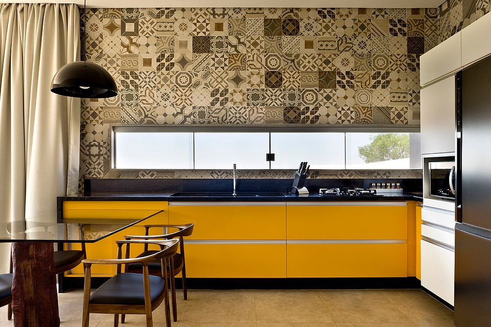 Monochromatic approach to patchwork of patterned tiles is great for the modern kitchen [Design: 1:1 arquitetura:design]