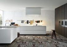 Monochromatic kitchen with patchwork tiled flooring