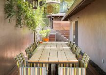 Multi-colored lanterns make a big statement in this narrow patio