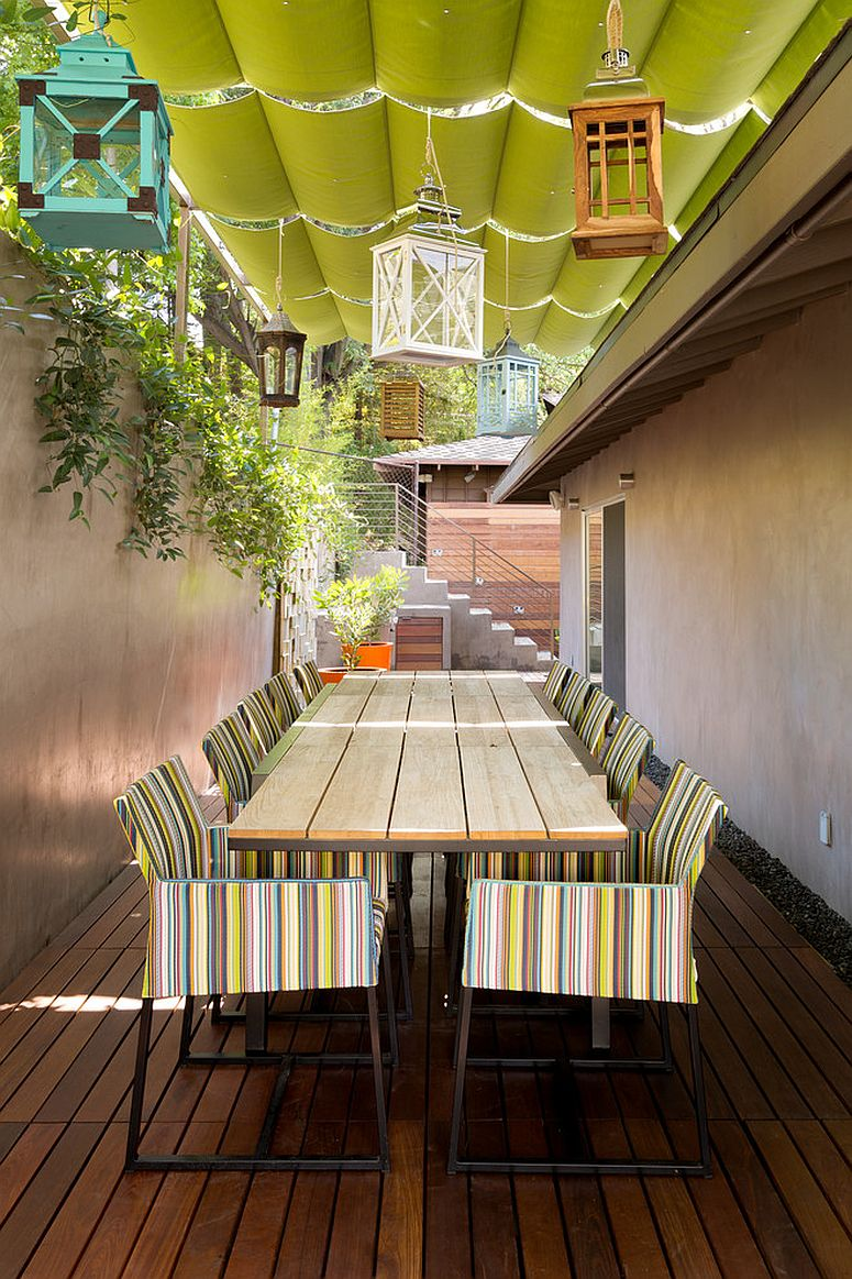 Multi-colored lanterns make a big statement in this narrow patio [Design: Go Green Construction]