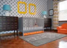 Nagoya Allover Stencil fashions the striking backdrop in this nursery