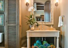 Neatly-folded-towels-and-open-vanity-add-color-and-style-to-the-traditional-bathroom-217x155