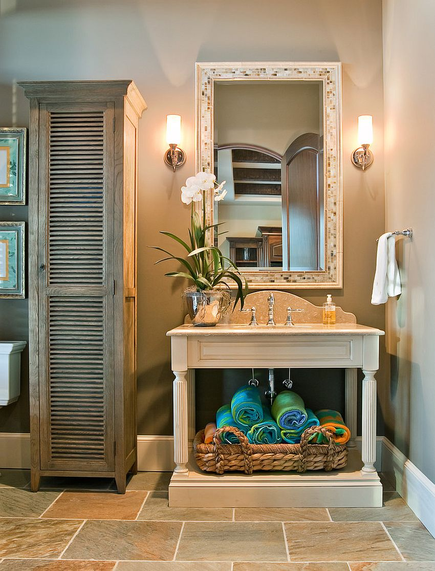 Neatly folded towels and open vanity add color and style to the traditional bathroom