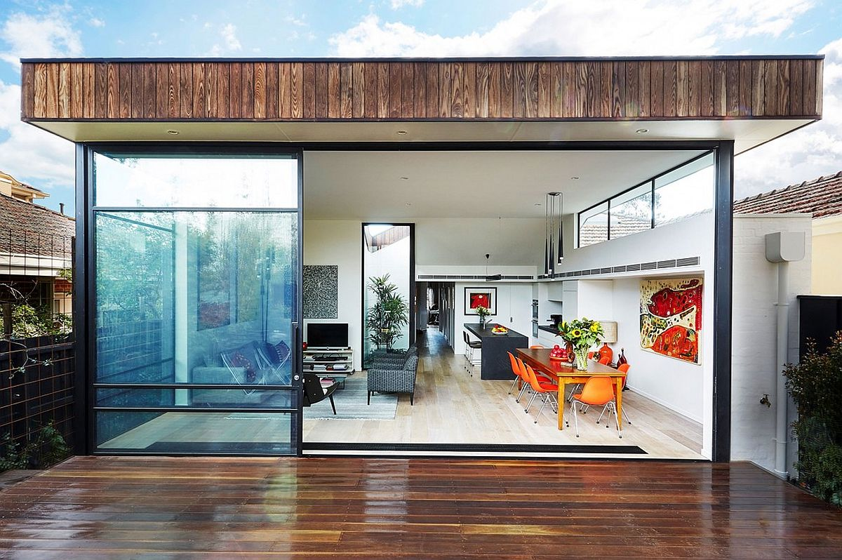 New open living area kitchen and dining space of the revamped Melbourne House Sensible Alterations Enliven Small, Semi Detached Melbourne House