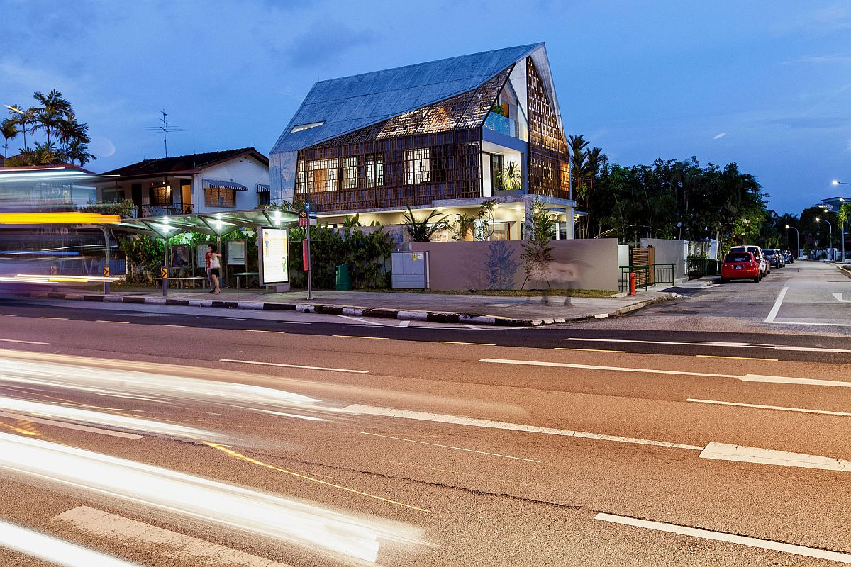 Night view of modern home in Singapore by Aamer Architects