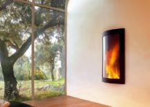 Open corner of a modern living space with a stunning and fiery focal point doubles as a meditation zone
