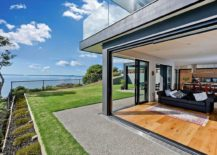 Open plan living are aon the lower level with sliding glass doors