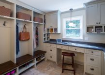 Open shelving in the mudroom gives it a more spacious look