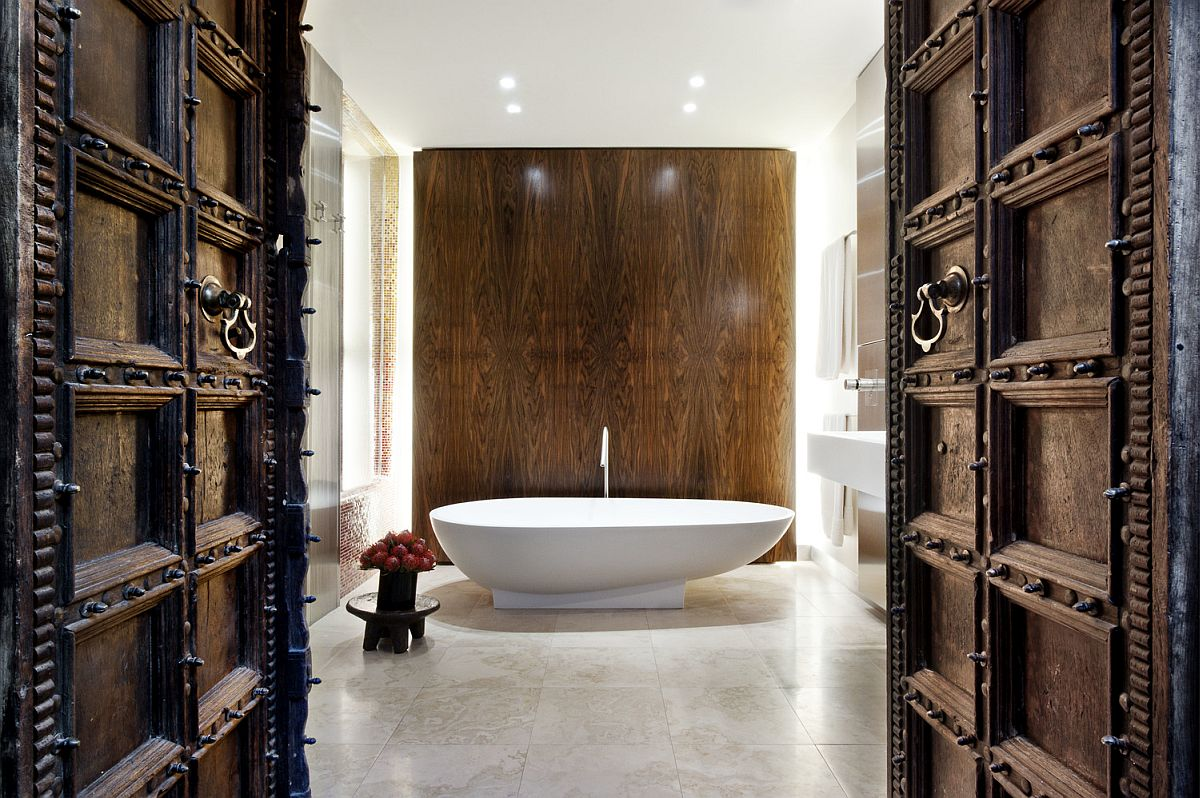 Oriental wooden doors and rich walnut wall for the contemporary bath