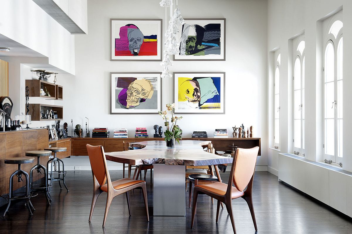 Original Andy Warhol skull prints stand out in the contemporary dining room