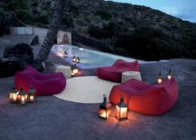 Outdoor lantern lighting next to the pool looks elegant and classic