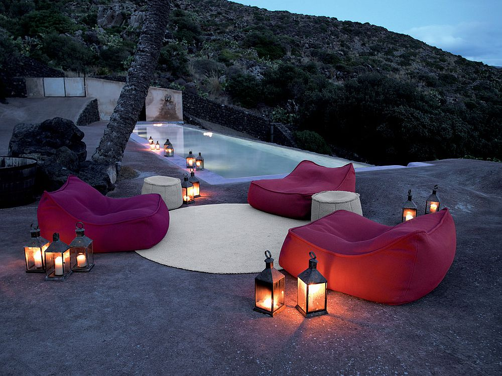 Outdoor lantern lighting next to the pool looks elegant and classic [Design: escale design]