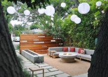 Outdoor retreat for the entire family laced with comfy decor and beautiful lanterns