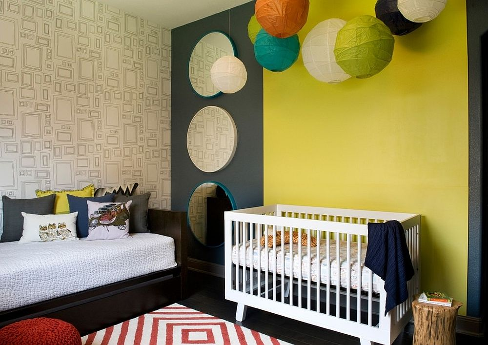 Paper lanterns bring additional color to this nursery in yellow and gray [Design: Robin Colton Studio]