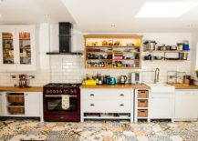Patchwork of lovely tiles makes up the floor of this smart Farmhouse kitchen 217x155 An Audacious and Trendy Mix: 25 Creative Patchwork Tile Ideas