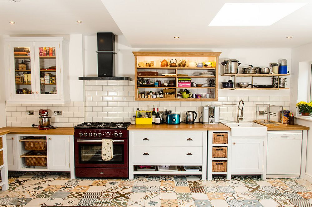 Patchwork of lovely tiles makes up the floor of this smart Farmhouse kitchen [Design: Clachan Wood]