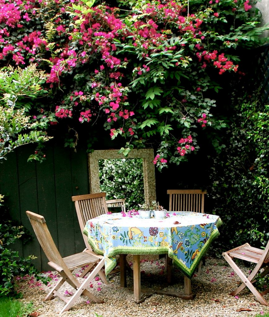 Patterned round tablecloth in a garden dining area