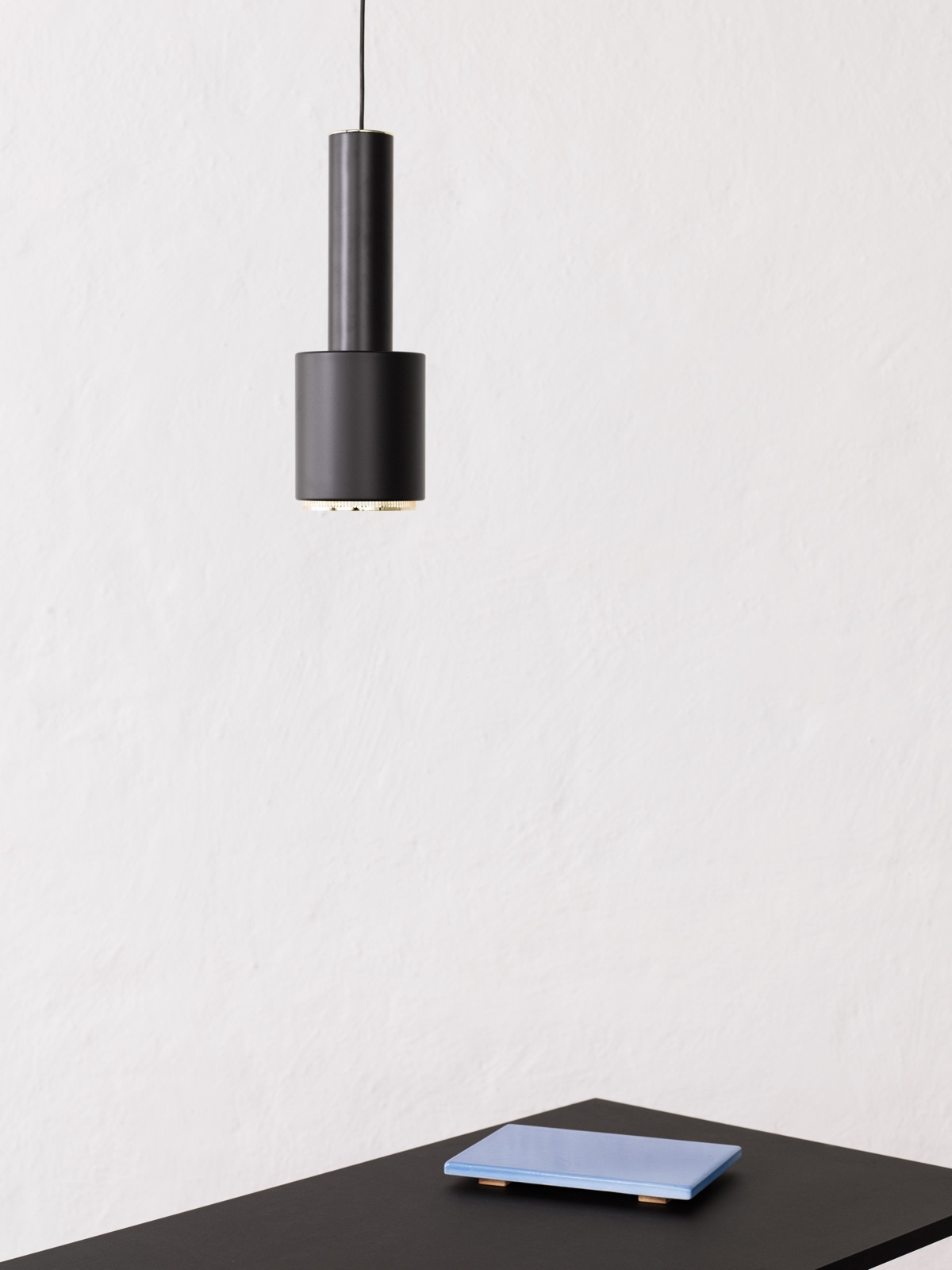 Pendant Light A110, black painted steel shade, designed in 1952. Photo by Osma Harvilahti. Also known as the Hand Grenade lamp, it was designed for the home of the Finnish Engineers' Association (designed by Aalto between 1948 and 1953).