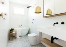 Pendant light adds warm metallic glint to the classy Scandinavian bathroom