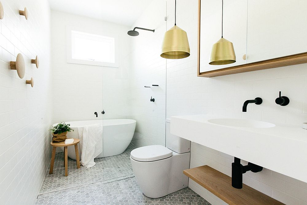Pendant light adds warm metallic glint to the classy Scandinavian bathroom [From: Caroline McCredie]