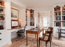 Picture lighting illuminates the open corner shelves in the home office beautifully