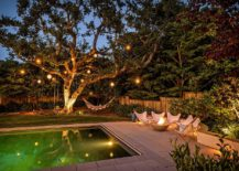 Poolside chairs, hammock and lanterns on trees for a mesmerizing backyard retreat!