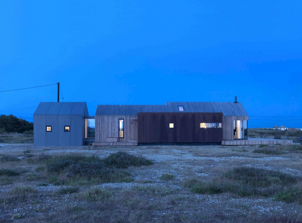 Pobble house at night, on Dungeness beach.