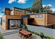 Powder coated metal cladding and stained cedar shiplap covers the extreior of the house 217x155 Sensible Makeover: Cliff Top Home in Auckland with Amazing Sea Views