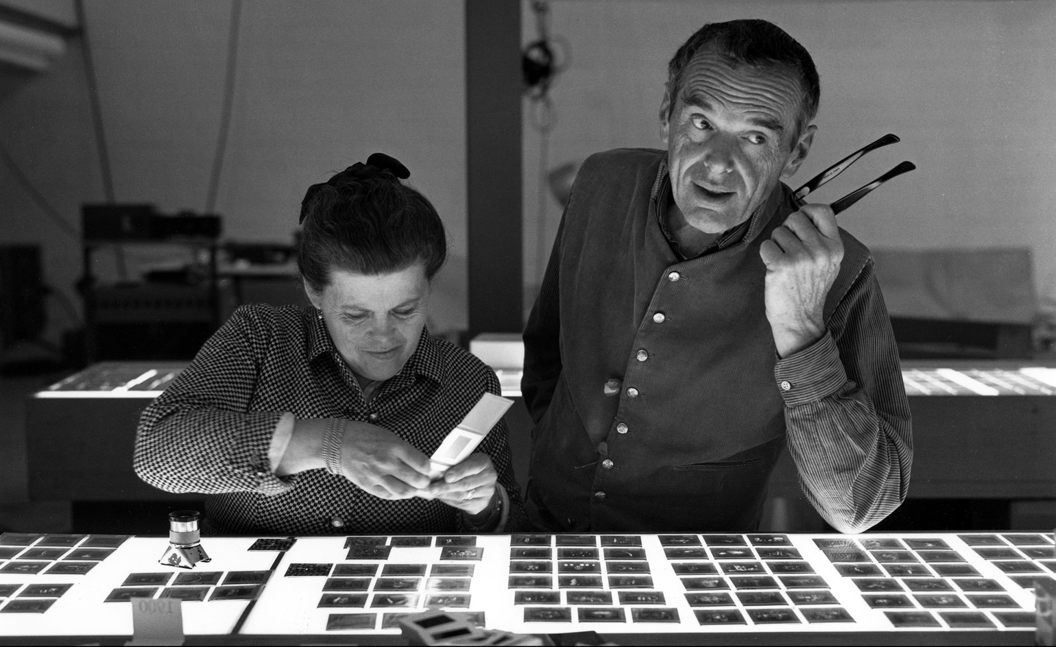 Ray and Charles Eames selecting slides. Image courtesy of Eames Office, LLC via Wallpaper*.