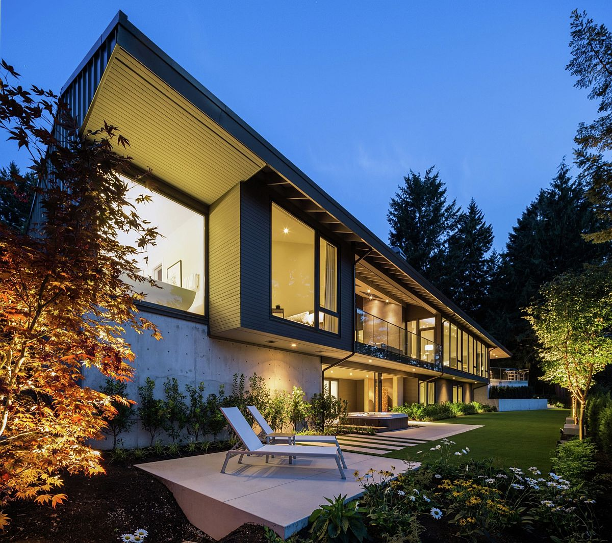 Rear facade of the home opens up to the natural scenery around it