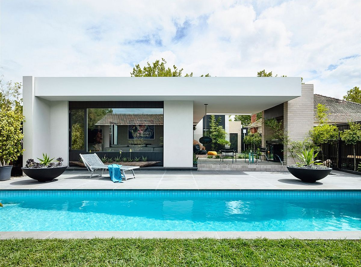 Rear garden and pool of Alphington House by InForm