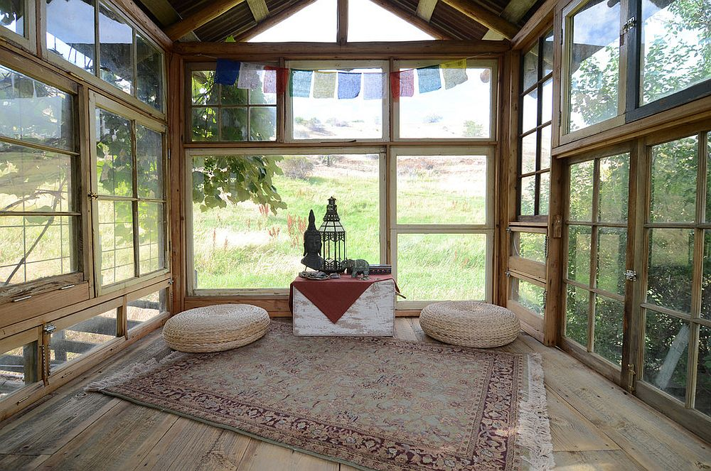View in gallery Reclaimed wood and glass shape rustic meditation shed  surrounded by greenery [From: Sarah Greenman