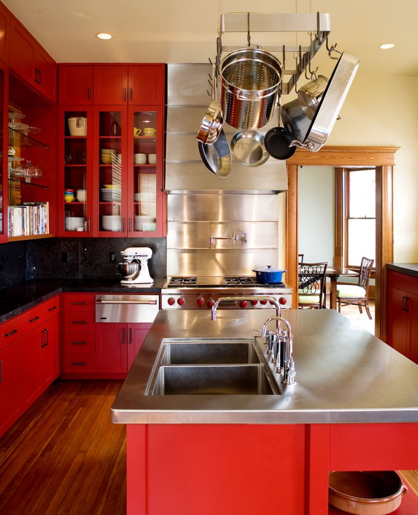 Red kitchen with pots overhead