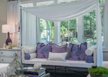 Relaxing daybed inside the sunroom with a splash of purple