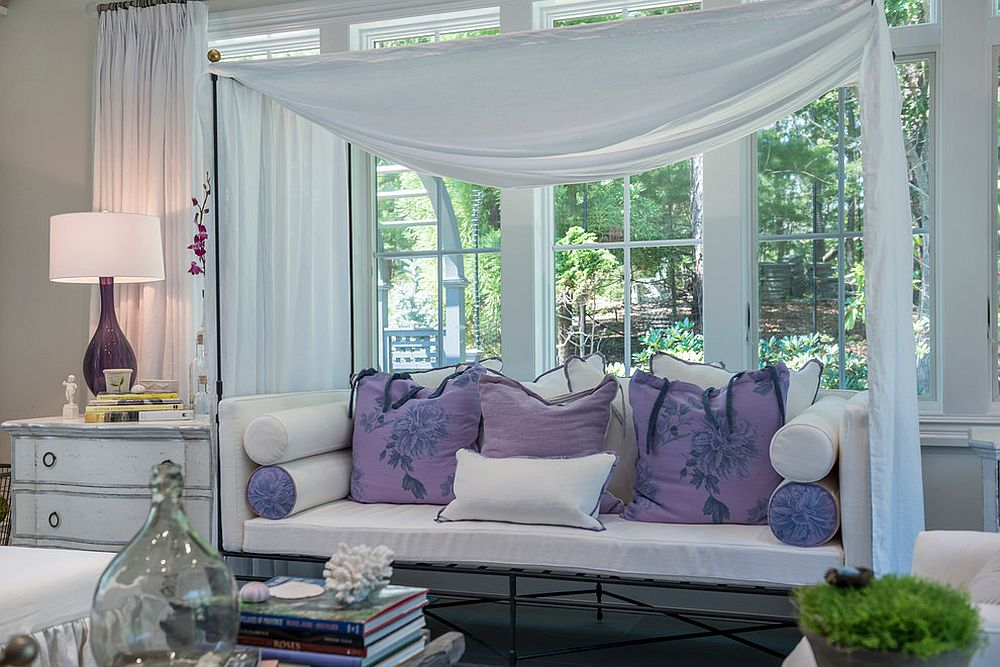 Relaxing daybed inside the sunroom with a splash of purple [Design: Debra Geller Interior Design]
