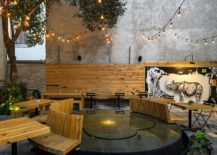 Revamped patio with water-mirror fountain, ample seating and lovley edison bulb lighting