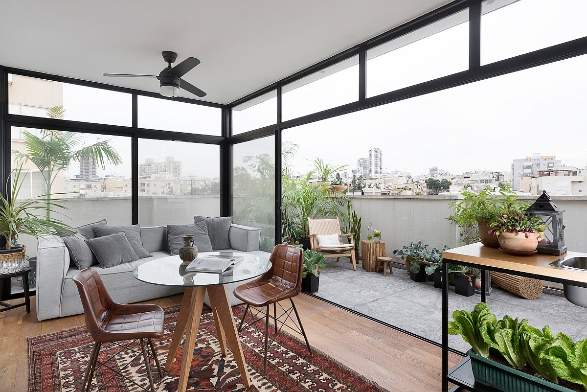Rooftop level living and balcony of the Tel Aviv home