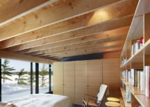 Rough-sawn-fir-gives-the-bedrooms-a-warm-cozy-ambiance-217x155
