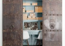Rustic and antique sliding doors add uniqueness to the small home office